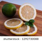 fresh lemon cut rings on bamboo ... | Shutterstock . vector #1292730088