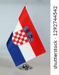 table flag of croatia  flagpole. | Shutterstock . vector #1292744542