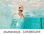 adorable kid swimming... | Shutterstock . vector #1292801245