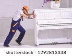 heavy loads concept. loader... | Shutterstock . vector #1292813338