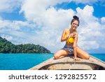 happy traveler asian woman in... | Shutterstock . vector #1292825572