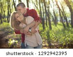 beautiful young couple in love... | Shutterstock . vector #1292942395