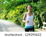 young asian woman jogging  at... | Shutterstock . vector #129295622
