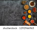 various spices spoons on stone... | Shutterstock . vector #1292966965