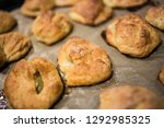 taste cakes or buns  lying on... | Shutterstock . vector #1292985325