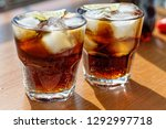 rum. cola cuba libre with lime... | Shutterstock . vector #1292997718