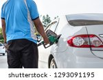 man worker fill car with petrol ... | Shutterstock . vector #1293091195
