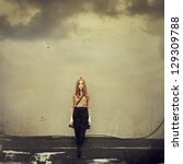 Beautiful girl hipster dreams of clouds. Art Photos