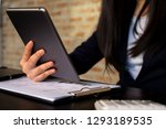 businesswoman using tablet to... | Shutterstock . vector #1293189535