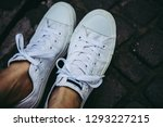 leg woman wear white sneakers... | Shutterstock . vector #1293227215