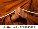 thai buddhist monks praying in... | Shutterstock . vector #1293235825