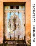 old wooden door in stone wall ...   Shutterstock . vector #1293246052