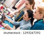 three girls at garment factory. ... | Shutterstock . vector #1293267292