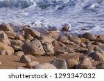 pebbles on the shore. stones in ...   Shutterstock . vector #1293347032