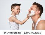 adorable little boy in tank top ... | Shutterstock . vector #1293402088
