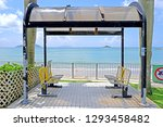 the busstop with yellow chairs... | Shutterstock . vector #1293458482