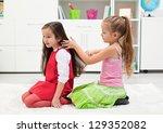 Happy Little Girl Combing Her...