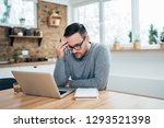 stressed young man sitting in... | Shutterstock . vector #1293521398