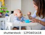 cute little baby boy  eating... | Shutterstock . vector #1293601618