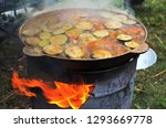 cooking a hot vegetable dish in ... | Shutterstock . vector #1293669778