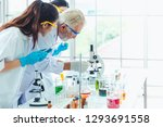 science teacher and students... | Shutterstock . vector #1293691558
