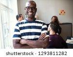 african designer smiling... | Shutterstock . vector #1293811282