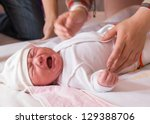 newborn baby crying on the bed  ... | Shutterstock . vector #129388706