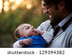 portrait of father and son... | Shutterstock . vector #129394382