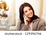 young happy woman sitting on... | Shutterstock . vector #129396746