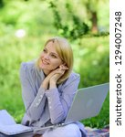 woman with laptop sit on rug... | Shutterstock . vector #1294007248