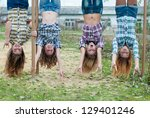 four young girls hanging upside ...   Shutterstock . vector #129401246