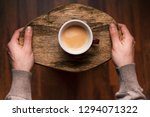 man holding a cup of coffee on... | Shutterstock . vector #1294071322