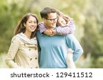 young happy family of three... | Shutterstock . vector #129411512