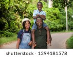 a family standing with their... | Shutterstock . vector #1294181578