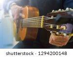 man tuning acoustic spanish...   Shutterstock . vector #1294200148