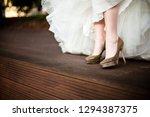 golden wedding shoes from white ... | Shutterstock . vector #1294387375