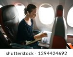 young woman working on plane | Shutterstock . vector #1294424692