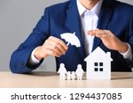 male insurance agent covering... | Shutterstock . vector #1294437085
