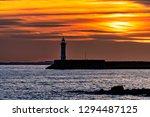 Sunset Sky With Lighthouse...