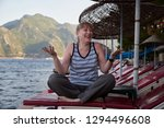 middle aged woman in a striped... | Shutterstock . vector #1294496608