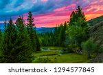 mountain forest sunset view.... | Shutterstock . vector #1294577845