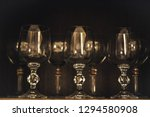 wine glasses on a wooden... | Shutterstock . vector #1294580908