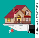 hand with small house and keys. ... | Shutterstock .eps vector #1294625815