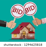 hands holding auction paddle.... | Shutterstock .eps vector #1294625818