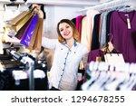 happy  positive female shopper... | Shutterstock . vector #1294678255