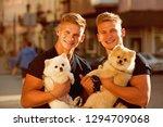 time for a walk. muscular men... | Shutterstock . vector #1294709068