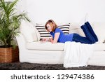 young teenager girl with laptop ... | Shutterstock . vector #129474386
