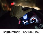 the man drive a car in the... | Shutterstock . vector #1294868152
