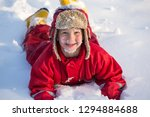 funny boy with snow on his face ... | Shutterstock . vector #1294884688