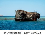 a badly corroded shipwreck of a ... | Shutterstock . vector #1294889125